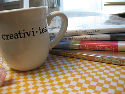 cup of tea and stack of picture books