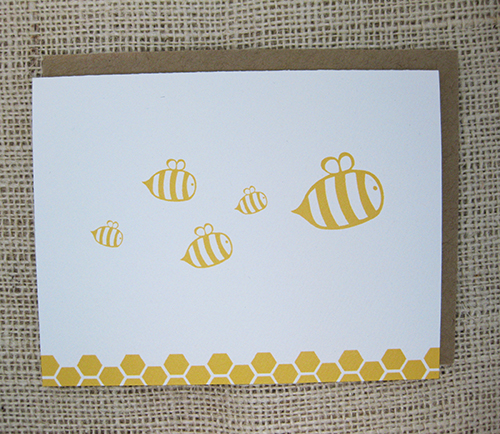 card with illustrations of flying bees