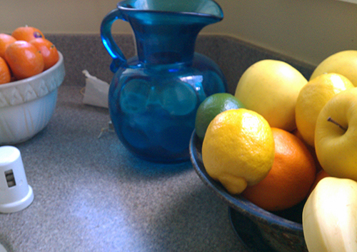 Bright Blue Glass Pitcher and bowl of fruit