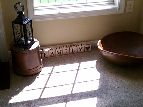 white wooden block spell out family in living room