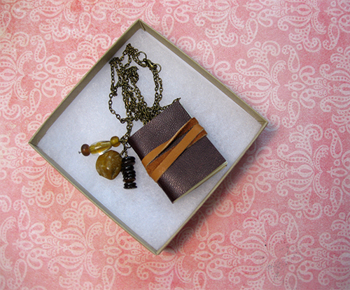 Just Terrific leather bound book necklace