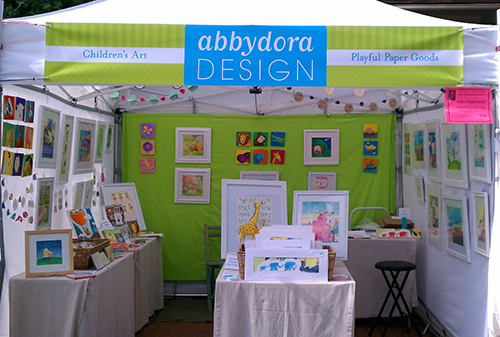 photo of AbbyDora Design booth showing children's art and handmade cards