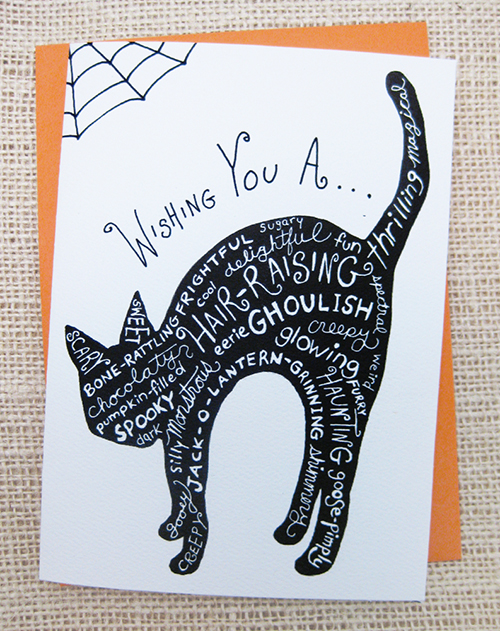 black cat silhouette with handlettering for halloween