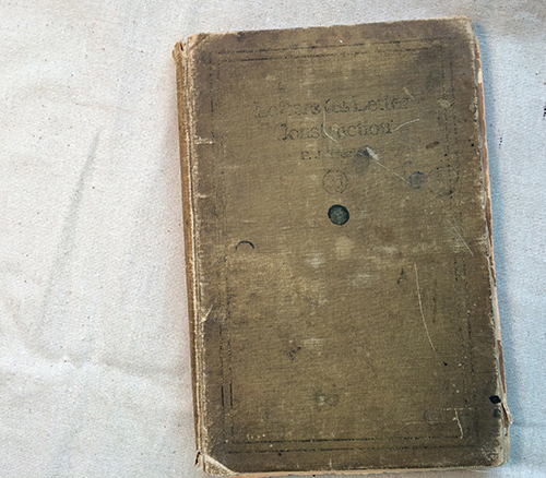 photo of aged hardcover book on handlettering