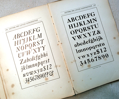 photo of interior book pages that show hand lettered alphabet