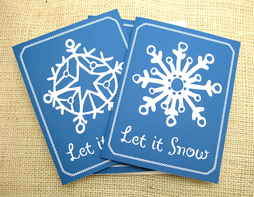 2014 holiday card with dark blue background and white snowflakes
