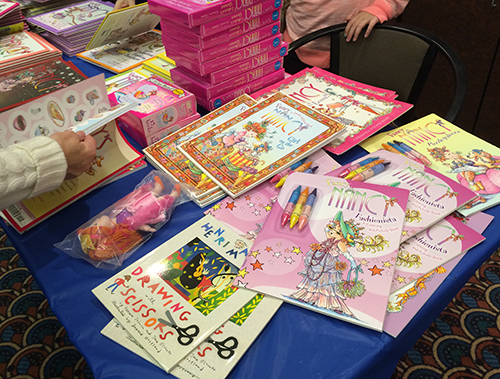 stacks of very pink Fancy Nancy books
