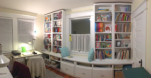 children's book designer's office with bookcases