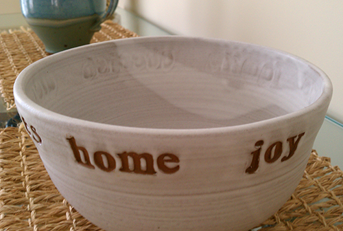 white ceramic bowl with home spelled out