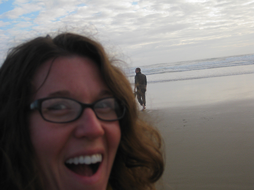 photo of lady with smile with beach in the background
