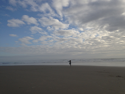 Photo of lady skipping at Beverly Beach OR