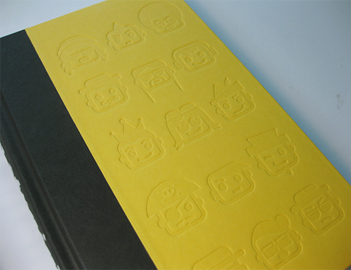 photo of yellow cover with embossed emoticons
