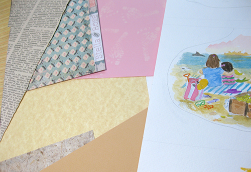 photo of collage paper and watercolor art on table