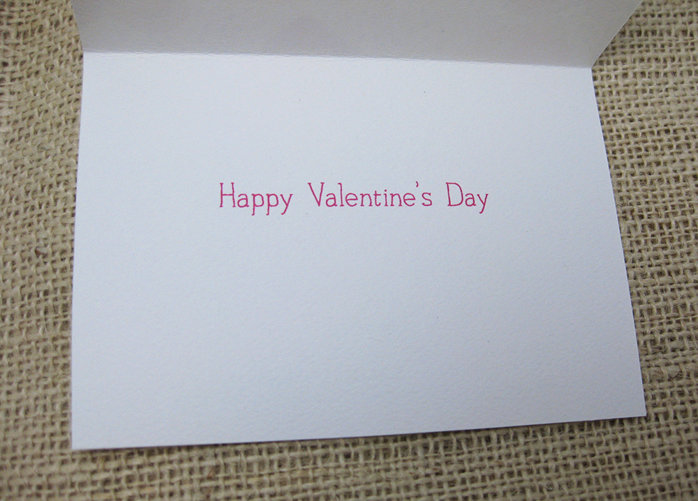 interior of card says happy valentines day in pink handwriting