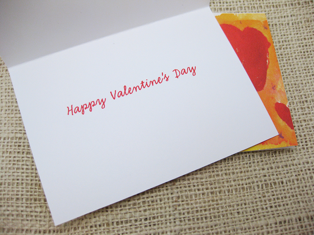 interior of card shows red cursive type saying happy valentines day