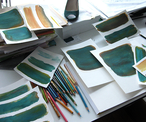 photo of several teal watercolor washes on paper