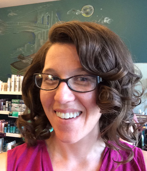 photo of Abby with glasses and vintage styled curly hair