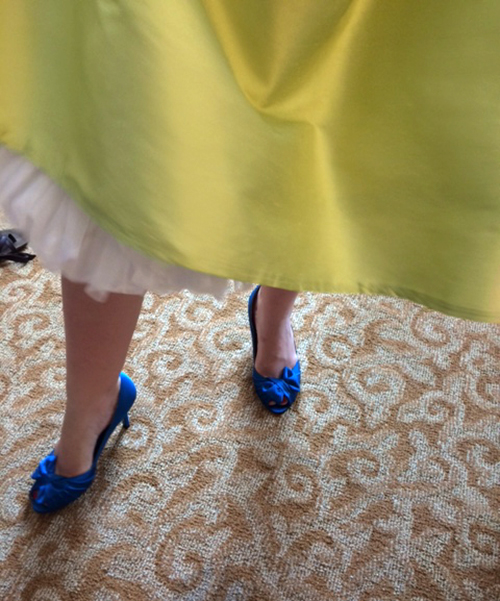 photo of bright blue heels and a green wedding dress