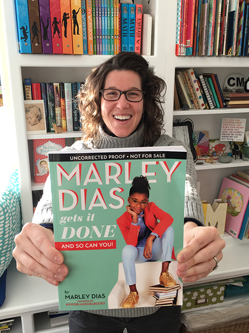 Abby Dening holding copy of the book called Marley Dias Gets It Done